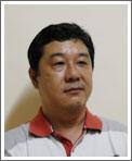 理事 買付代行部門 上野 仁志 写真